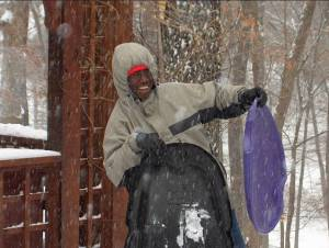 Abubakar plays in the snow during his first stay in Iowa in 2001