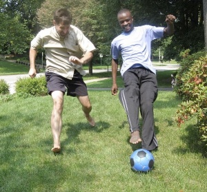 TJ plays soccer with his dad, Mike Jackson