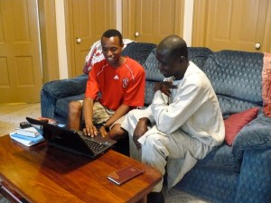 Dennis teaching Anyam to use a computer