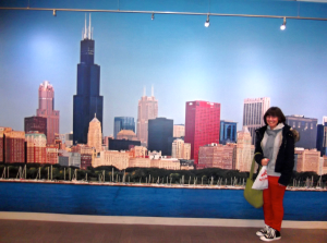 Saedah posing next to the Chicago skyline at a museum.