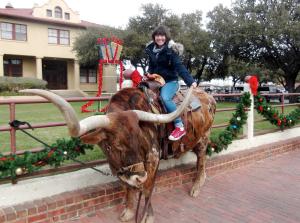 Saedah riding a Texas Longhorn
