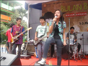 Diyah performing with her band.