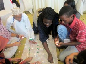 Shughaib (left) putting together a demonstration model at the workshop.