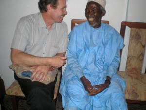 Del visiting with a program participant abroad