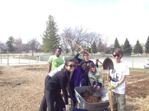 YES students prepare to mulch the garden.