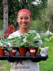 Meutia Hakim prepares to start planting some vegetables and fruits.