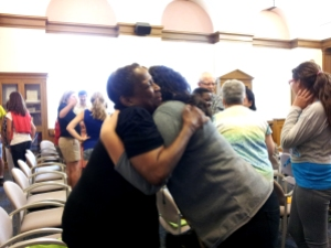 2013-2014 YES student, Mariam Hanna, and host parent, Linda Stanley, hug each other for the first time.